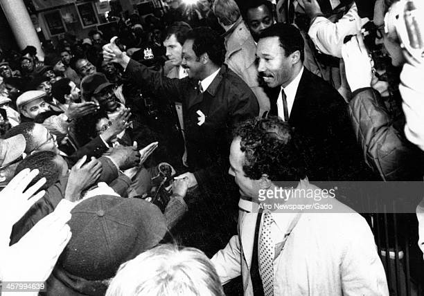 Civil rights activist Jesse Jackson Sr gives the Thumbs Up signal while delivering a speech to an excited crowd 1975