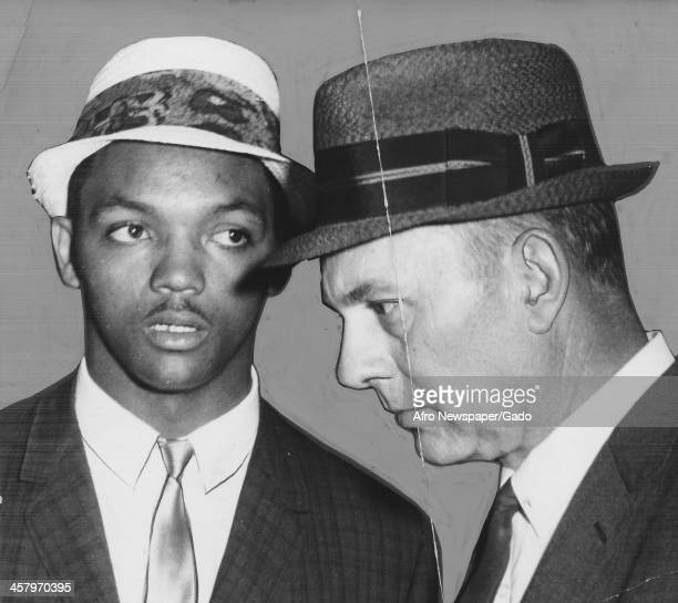 Civil rights activist Jesse Jackson Sr speaks to William Jackson of the Greensboro Police Department after a civil rights student demonstration,...