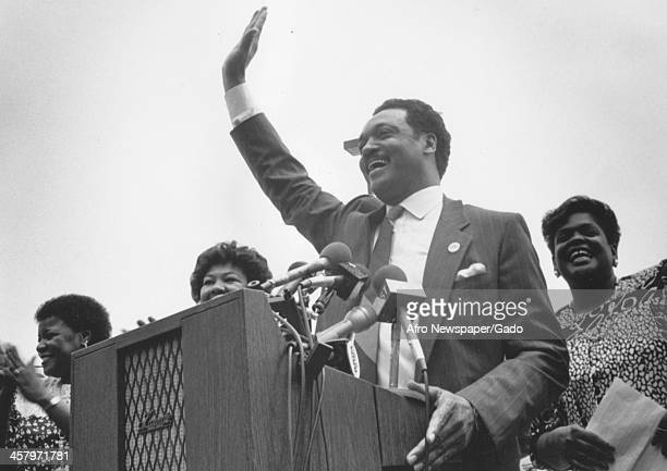 Civil rights activist Jesse Jackson Sr waves to a crowd while delivering a speech, 1960.