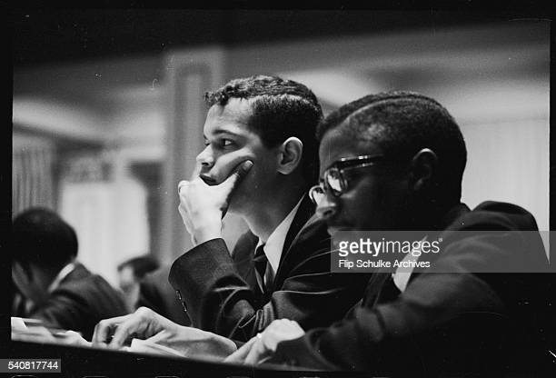 Civil rights activist Julian Bond sits with an aide during his first session as a Georgia legislator. Bond was Georgia's first African American state...