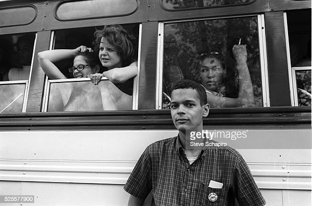 Civil rights activist Julian Bond stands next to a bus full of young people taking part in the Congress of Racial Equality training session. The...