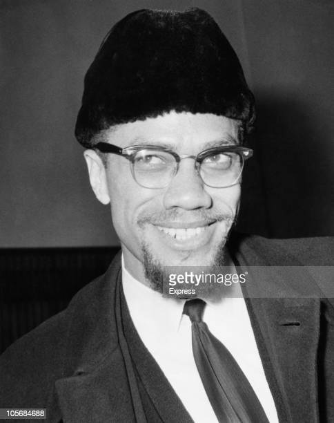 Civil rights activist Malcolm X arrives at London Airport, 9th February 1965. He has flown back from Paris-Orly, having been refused admittance to...
