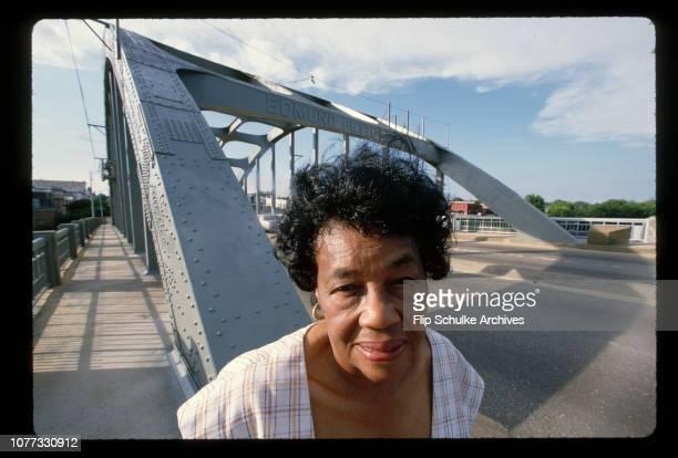 Civil rights activist Marie Foster stands on the Edmund Pettus Bridge in Selma, Alabama.