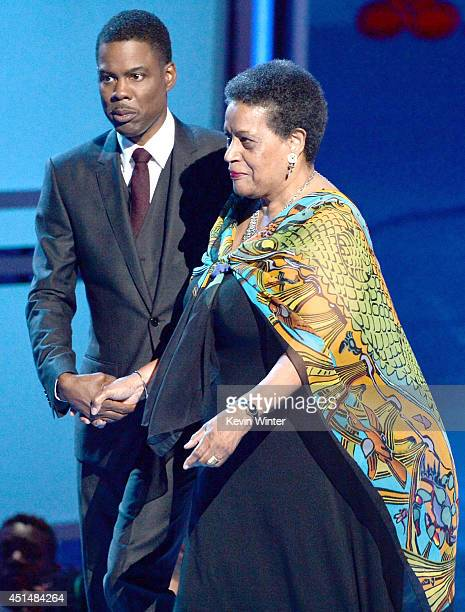 Civil rights activist Myrlie EversWilliams accepts the BET Humanitarian Award with host Chris Rock onstage during the BET AWARDS '14 at Nokia Theatre...