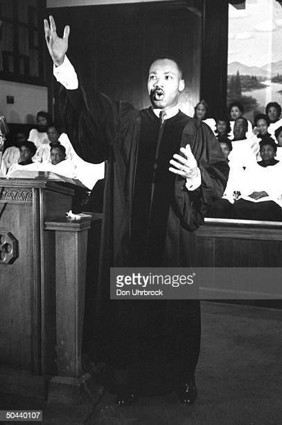 Civil Rights activist Rev Dr Martin Luther King Jr gesturing toward heaven while delivering sermon at Ebenezer Baptist Church