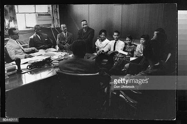 Civil Rights activist Rev. Dr. Martin Luther King Jr. Talking w. A college group of 12 male & female student sit-in organizers incl. Julian Bond...