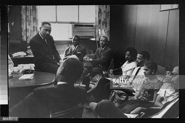 Civil Rights activist Rev. Dr. Martin Luther King Jr. Talking w. A college group of male & female student sit-in organizers incl. Julian Bond ,...