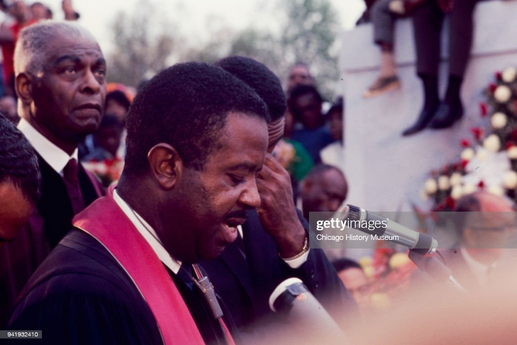 Civil Rights activist Reverend Ralph Abernathy (1926 - 1990) speaks at Dr Martin Luther King Jr's burial service at South View Cemetery, Atlanta, Georgia, April 9, 1968. Among those visible beside him is fellow Civil Rights and religious leader Benjamin May (1894 - 1984) (left).