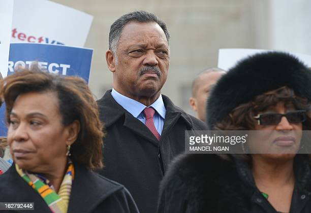 Civil rights activist the reverend Jesse Jackson listens to a speaker at a press conference infront of the US Supreme Court on February 27 2013 in...