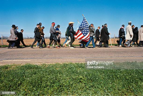 Civil rights activists carry an American flag during their march from Selma to Montgomery to protest denial of voting rights to African Americans