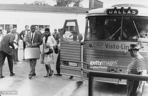 Civil rights activists known as the Freedom Riders disembark from their bus , en route from Montgomery, Alabama, to Jackson, Mississippi, as they...