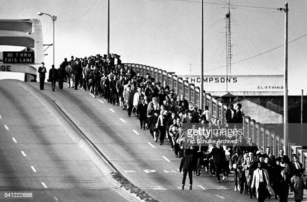 Civil rights activists march across the Edmund Pettus Bridge, starting the second march to Montgomery. In the first march, the marchers had been...