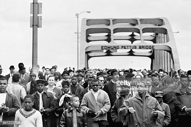 Civil rights activists march across the Edmund Pettus Bridge starting the second march to Montgomery In the first march the marchers had been...