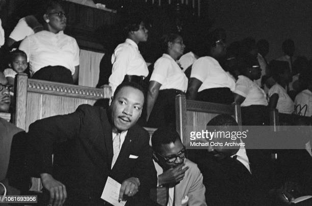 Civil rights activists Martin Luther King Jr. And Fred Shuttlesworth hold a rally at a church in Birmingham, Alabama, 14th October 1963.