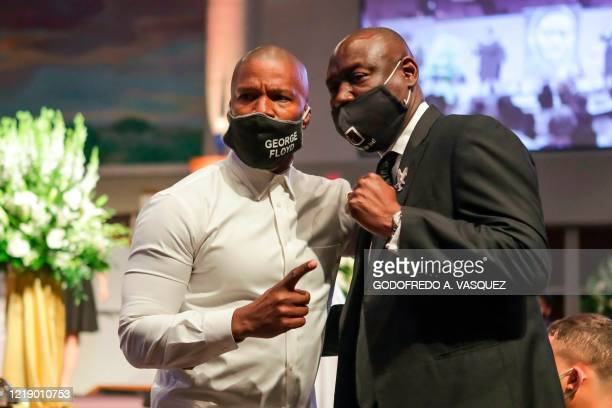 Civil rights and Floyd family attorney Ben Crump poses for a picture with actor Jamie Foxx after George Floyd's funeral on June 9 at The Fountain of...