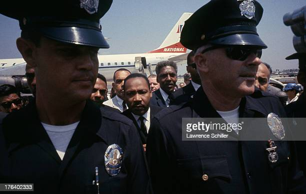 Civil Rights and religious leader Dr Martin Luther King Jr arrives at Los Angeles International Airport during the Watts Riots Los Angeles California...