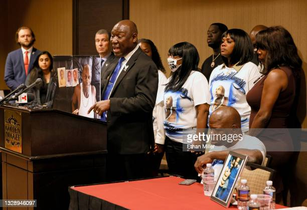 Civil rights attorney Ben Crump points at a photo of Byron Williams while surrounded by his family and family members of George Floyd during a news...
