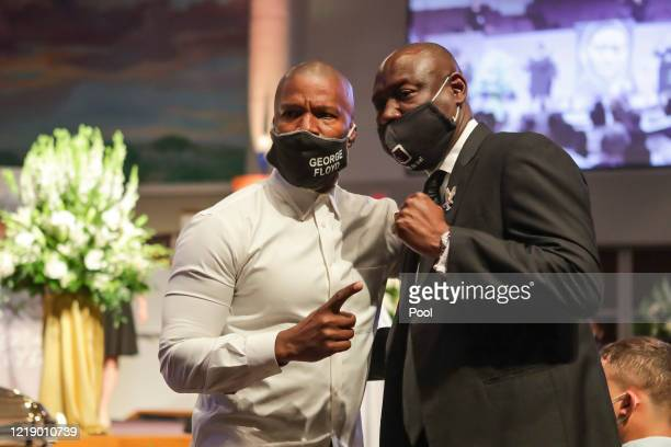 Civil rights attorney Ben Crump poses for a picture with actor Jamie Foxx after the funeral for George Floyd, at The Fountain of Praise church on...