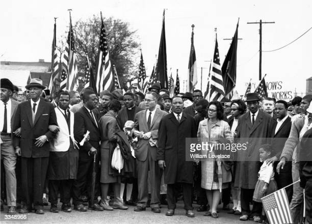 Civil rights campaigner Dr Martin Luther King with his wife Coretta Scott King, at a black voting rights march from Selma, Alabama, to the state...
