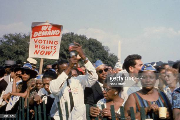 Civil rights demonstrators are restricted by a fence at the March on Washington Washington DC August 28 1963 The Washington Monument is visible in...