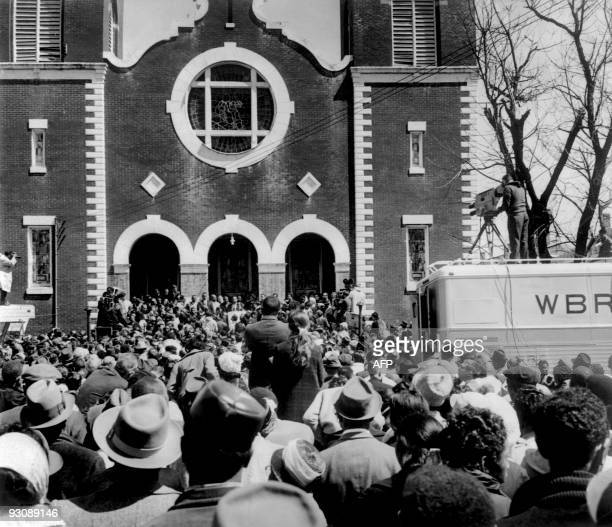 Civil rights demonstrators, led by Dr Martin Luther King , arrive in front of the Brown Chapel AME Church in Montgomery from Selma on March 26, 1965...