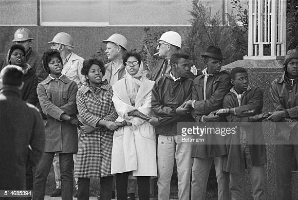 Civil rights demonstrators link hands and sing during a protest at the Dallas Country Courthouse in Selma Alabama Later Sheriff Jim Clark ordered...