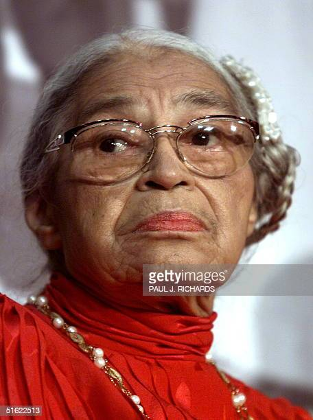 Civil rights heroine Rosa Parks attends the opening of Marching Toward Justice The History of the 14th Amendment of the US Constitution ribbon...