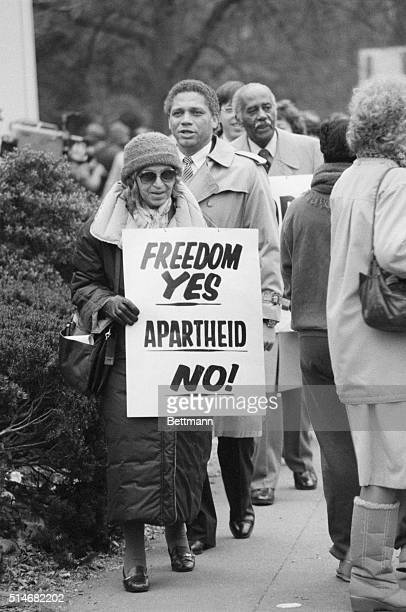 Civil rights heroine Rosa Parks carries a sign outside the South African Embassy in Washington It reads 'Freedom Yes Apartheid No' | Location Embassy...