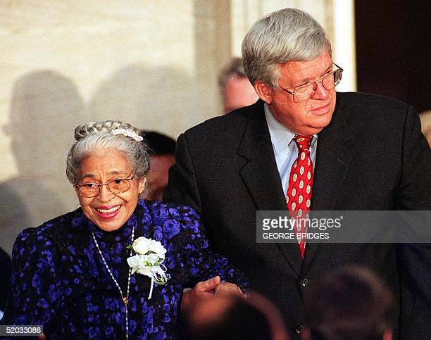 Civil rights heroine Rosa Parks is escorted by US House Speaker Dennis Hastert as she arrives for ceremonies 15 June 1999 in the Rotunda at the US...