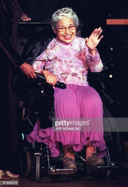 Civil rights icon Rosa Parks waves to the audience before receiving the Congessional Medal of Honor at a ceremony 28 November 1999 in Detroit Mrs...