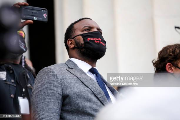 Civil rights lawyer and activist Lee Merritt looks out onto the crowds during at the Lincoln Memorial during the Commitment March on August 28, 2020...