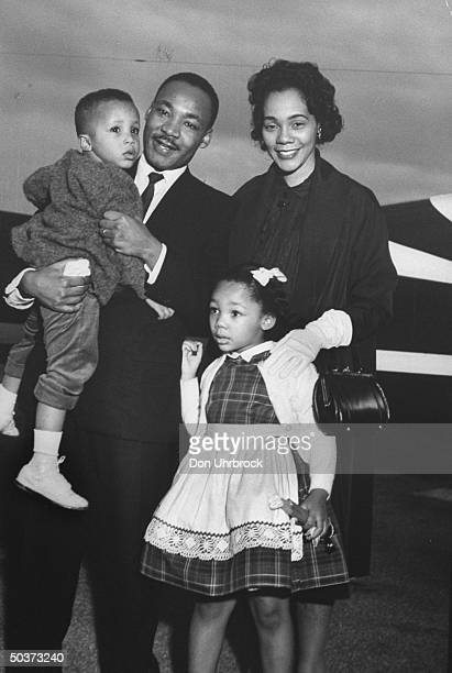 Civil Rights ldr Dr Martin Luther King Jr holding his son Martin III as his daughter Yolanda and wife Coretta greet him at the airport upon his...