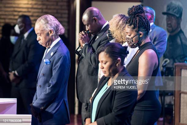 Civil rights leader Al Sharpton stands with others as they bow their heads during a memorial service in honor of George Floyd on June 4 at North...