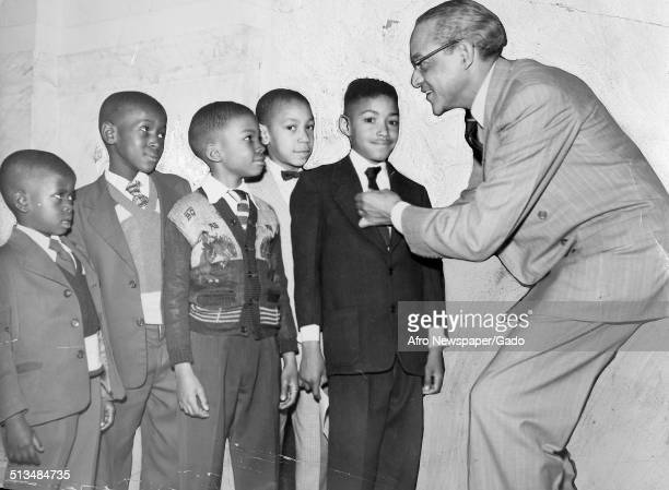 Civil Rights leader and judge Raymond Pace Alexander and defendants in the Girard College civil rights case conversing, New Jersey, September 21,...