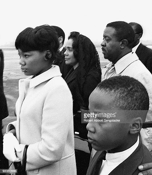 Civil rights leader Coretta Scott King is accompanied by daughter Yolanda son Martin Luther King III and the Reverend Ralph Abernathy as she arrives...
