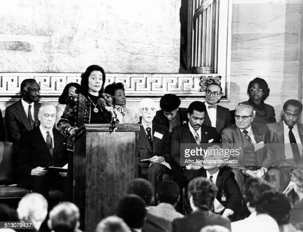 Civil Rights leader Coretta Scott King speaking at a podium 1985