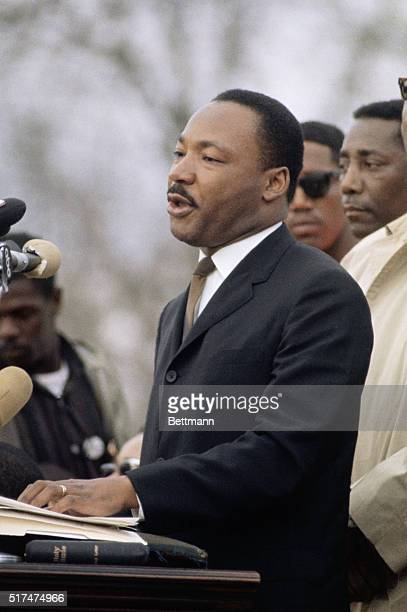 Civil rights leader Dr. Martin Luther King at the podium giving a speech in Montgomery, Alabama, after the Selma to Montgomery Civil Rights March.