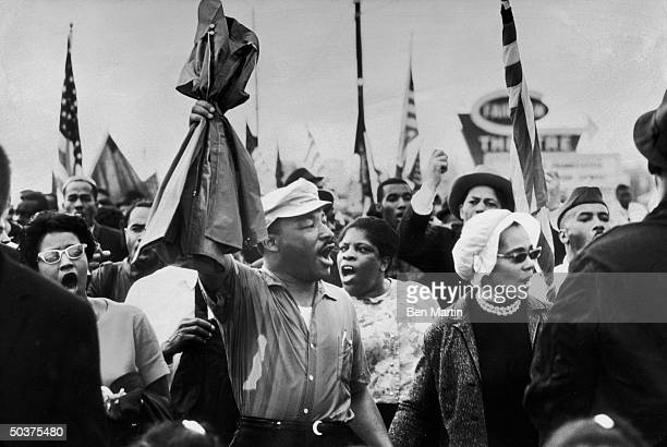 Civil Rights leader Dr Martin Luther King Jr and wife Coretta Scott King looking energized as they lead demonstrators on the fourth day of their...