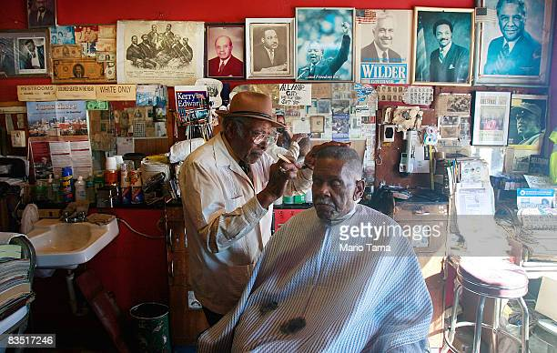 Civil Rights leader James Armstrong cuts Spencer Hill's hair in his barber shop where he also cut Dr Martin Luther King Jr's hair October 31 2008 in...