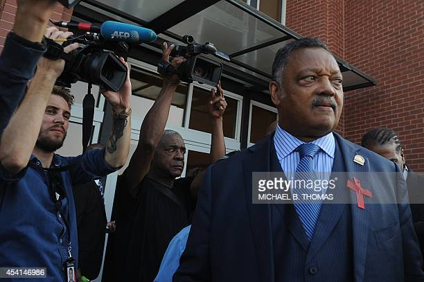 Civil Rights Leader Jesse Jackson speaks to the media before entering the Friendly Temple Missionary Baptist Church for the funeral of slain 18year...