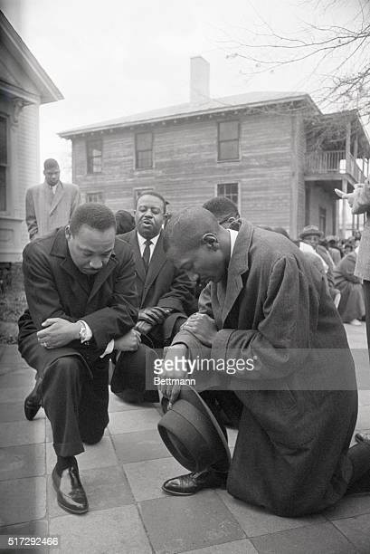 Civil rights leader Martin Luther King Jr and Ralph Abernathy kneel with a group in prayer prior to going to jail in Selma Alabama The group was...