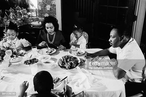 Civil rights leader Martin Luther King Jr eats lunch with his family after church services and learning that he won the Nobel Peace Prize