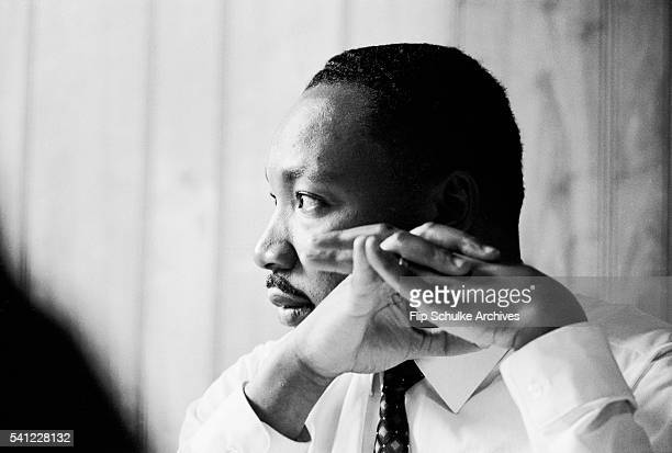 Civil rights leader Martin Luther King Jr listens at a meeting of the SCLC staff at an Atlanta restaurant