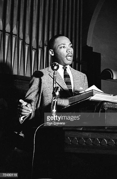 Civil rights leader Martin Luther King Jr speaking at a rally during the bus boycott