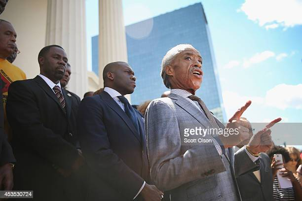 Civil rights leader Rev Al Sharpton speaks about the killing of teenager Michael Brown at a press conference held on the steps of the old courthouse...
