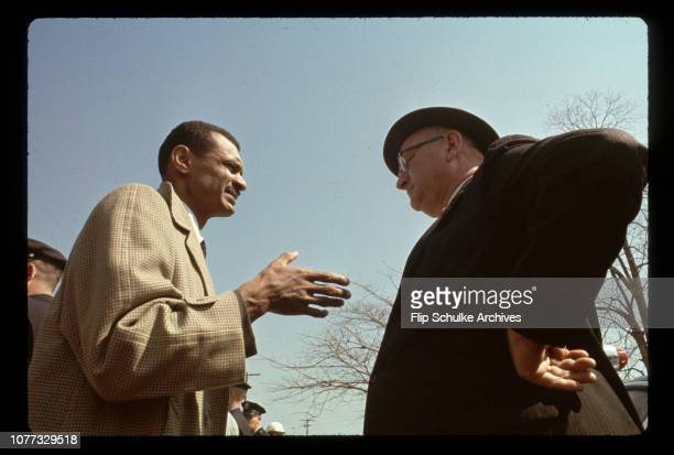 Civil rights leader Reverend C.T. Vivian talks to Director of Public Safety Wilson Baker before march from Selma.