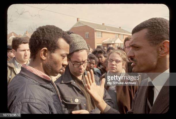 Civil rights leader Reverend C.T. Vivian talks to marchers in a black neighborhood of Selma.