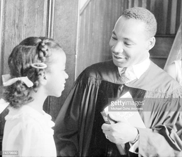 Civil rights leader Reverend Martin Luther King Jr speaks with people after delivering a sermon on May 13 1956 in Montgomery Alabama