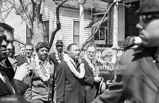 Civil rights leaders Ralph Abernathy, Martin Luther King Jr., former UN Ambassador Ralph Bunche, and Rabbi Abraham Joshua Heschel wear leis during...