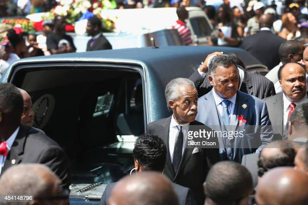 Civil rights leaders Rev Al Sharpton an Rev Jesse Jackson wait for the remains of Michael Brown to be loaded into a hearse following his funeral...